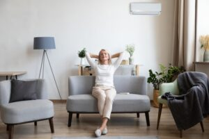 woman-leaning-back-on-couch-looking-comfortable-in-her-home
