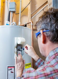 technician-working-on-water-heater-tank